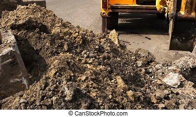 Pile of dirt. Bucket of excavator. Building new roads. Work...