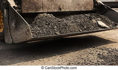 Shovels throwing asphalt. Bucket of wheel loader. Use more...