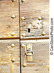 capronno rusty brass a door curch closed wood italy lombardy...