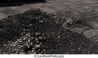 Milled asphalt pile. Small rocks on the ground. City roads...