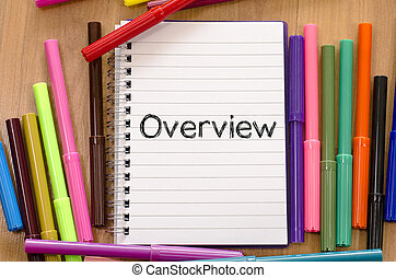 Overview written on notepad - Human hand writing overview on...