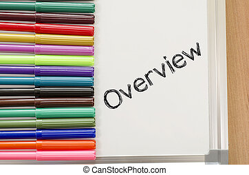 Overview written on whiteboard - Human hand writing overview...