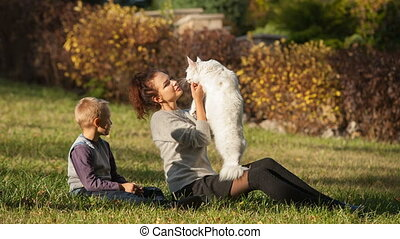young lady and boy with Maine Coon cat