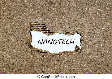 The word nanotech appearing behind torn paper