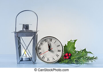 Christmas lantern with Holly leaves and berries  and  Christmas clock