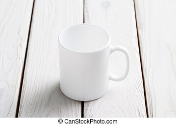 White cup mock-up on wooden table - White empty cup mock-up...