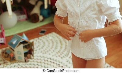 Girl buttoning her shirt - In white shirt girl buttoning