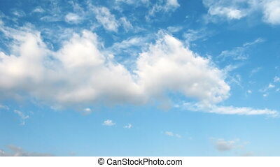 Light transparent clouds moving on the blue sky background....