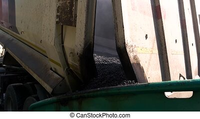 Tipper with asphalt. Back view of a truck. Material for road...