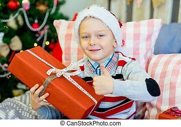 happy child boy with Christmas gifts - happy child boy with...