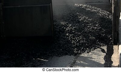 Machine laying asphalt. Part of a road paver. Main material...