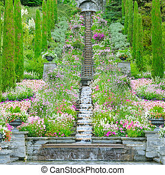 Flower garden and other plants, a staircase and a waterfall on the island of Mainau (Lake Constance, Germany)