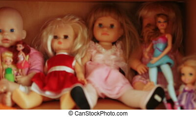 Several dolls on shelf - Girlish dolls on shelf cabinet