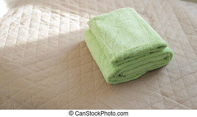 Woman putting a flower on a clean green towels