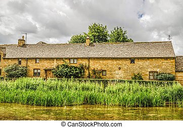 Terrace cottages at Lower Slaughter - View across the River...