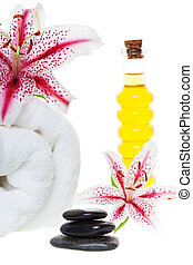 Spa products with stones, on a white background