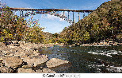 New River Gorge Bridge in West Virginia - Rapids under the...