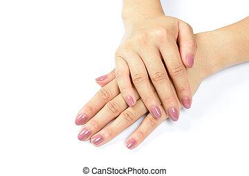 woman painting her fingernails