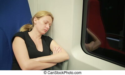 woman riding on the train and sleeping