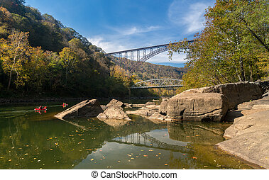Kayakers at the New River Gorge Bridge in West Virginia -...