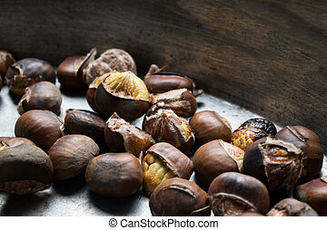 Chestnuts roasted - Background of roasted chestnuts seasonal...
