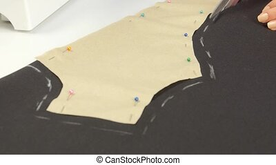 Cutting fabric with scissors. Close up - Cutting fabric with...