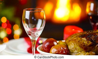 wine pouring to glass on christmas table in front of...
