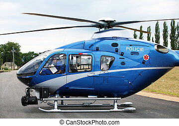 Police helicopter - Blue and silver police helicopter taking...
