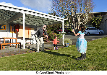 Granddad plays with his daughters outdoor - Granddad (age...