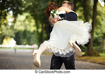 Never let you down -- groom whirls a bride