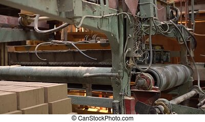 Industry. View of production machine with bricks, close-up