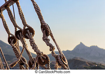 rigging ropes sailing ship and mountain landscape