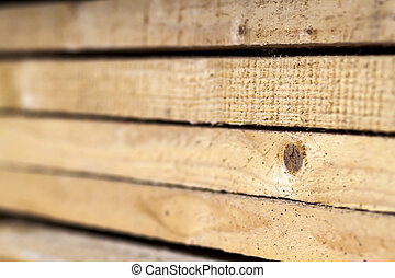 Stack of new wooden studs at the lumber yard. Wood timber...