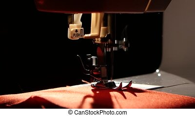 Sew red fabric. Close up - Sew red fabric, black background,...