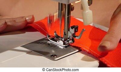 Treat the fabric edge. Close up - Treat the fabric edge,...