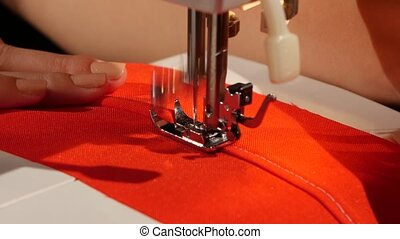 Stitch on red fabric. Close up - Stitch on red fabric, woman...