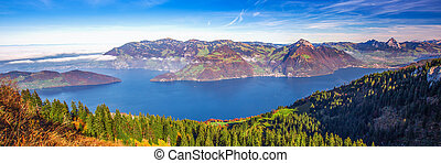 Fog surrounding Grosser, Kleiner Mythen, Lake Lucerne, Rigi mountain, Brunnen city and Weggis village from Klewenalp Swiss Alps, Central Switzerland