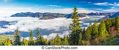 Fog surrounding Grosser, Kleiner Mythen from Klewenalp, Switzerland