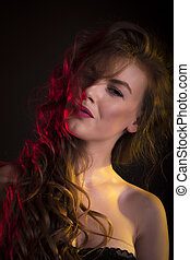 Stuning woman with shadow on her face and long hair -...