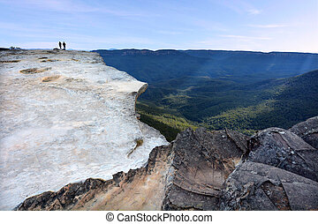 People hikes on Lincoln Rock Lookout at sunset of the Grose...