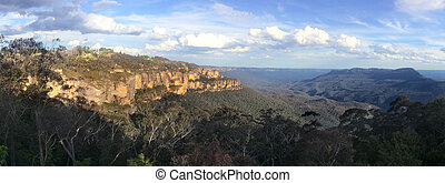 Panoramic landscape view of The Three Sisters rock formation...