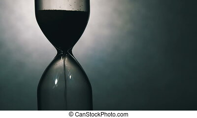 Sandglass on a White Background, the sand Falls Inside -...