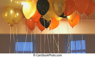 Colorful balloons floating on the ceiling indoors - Colorful...