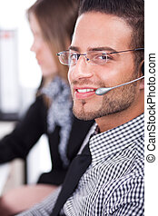 Business executive servicing the customer through head phone...