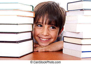 Young kid relaxing between pile of books