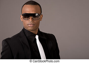 Ethnic young business man wearing sunglasses