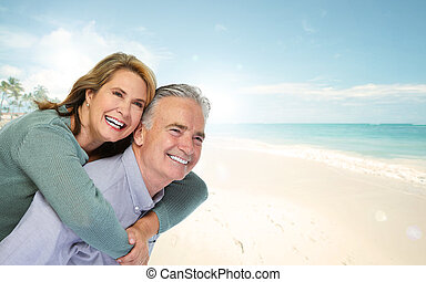 Senior couple on beach.