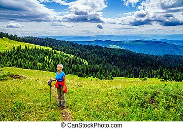 Senior Woman enjoying the View from Tod Mountain