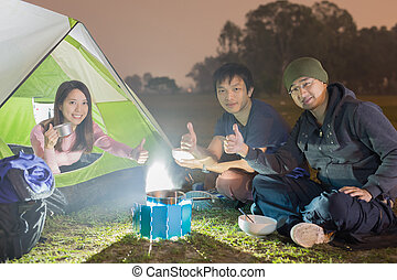 people are camping outdoor with tent, asian