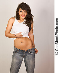 Sexy woman  in unbuttoned jeans and tank-top